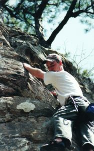 man climbing outdoors